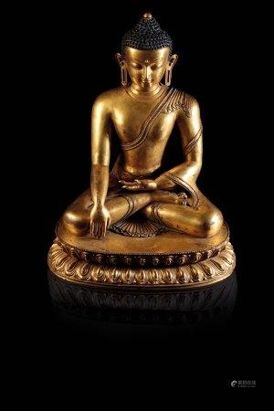 FINE GILT-BRONZE FIGURE OF BUDDHA SHAKYAMUNI, TIBET, 15TH CENTURY