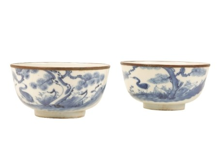 PAIR OF BLUE AND WHITE 'CRANE AND PINE TREES' BOWLS, KANGXI PERIOD