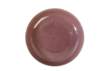 RARE AUBERGINE-GLAZE CARVED 'STORKS AND PINE TREE' DISH, YONGZHENG SIX CHARACTER MARK