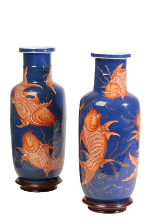 FINE PAIR OF IRON-RED AND GILT-DECORATED 'CARP' ROULEAU VASES, QING DYNASTY, 19TH CENTURY