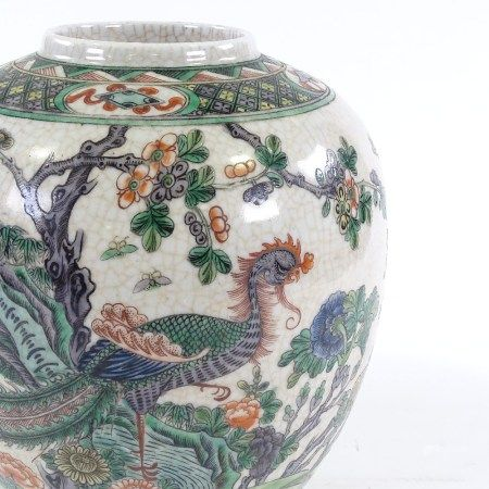 A Chinese porcelain jar with hand painted exotic bird, height 25cm
