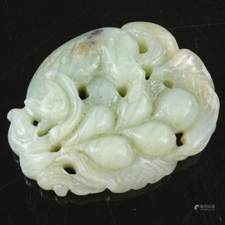 A Chinese relief carved jade pendant, length 5cm
