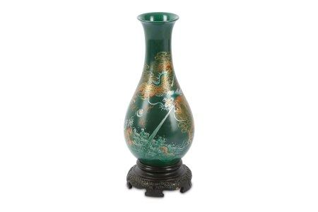 A green lacquered Chinese vase.