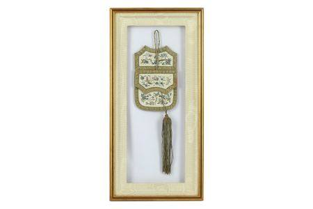 A framed and glazed Chinese silk 'pocket'.