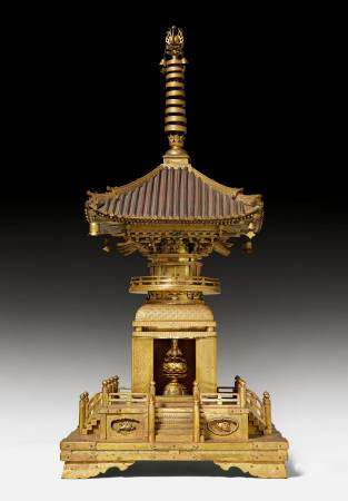 A VERY RARE BUDDHIST RELIQUARY IN THE SHAPE OF A PAGODA.