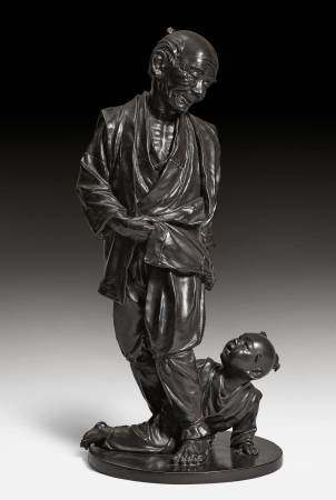 A LARGE BRONZE FIGURE OF AN OLD MAN AND A BOY.
