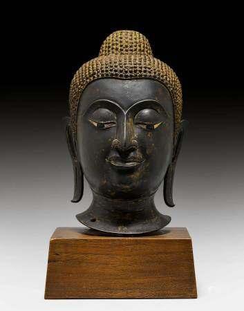 A BRONZE HEAD OF BUDDHA.