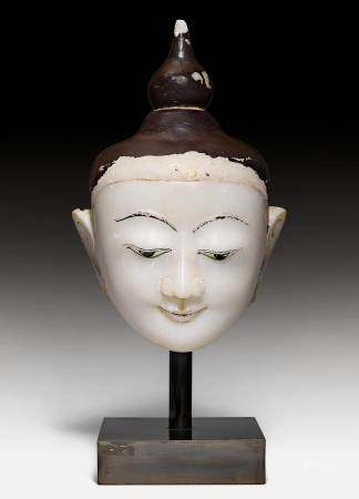 A LARGE ALABASTER HEAD OF BUDDHA.