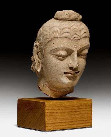 A FINE STUCCO HEAD OF BUDDHA.