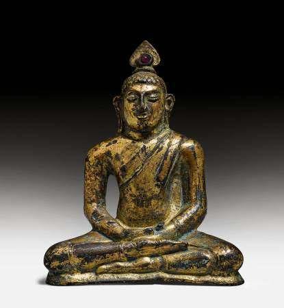 A GILT BRONZE FIGURE OF BUDDHA.