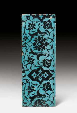 A RECTANGULAR BLACK AND TURQUOISE TILE.
