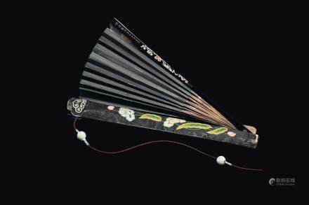 A lacquered wood fan, China, Qing Dynasty, 19th century