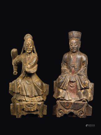 A pair of carved polychrome wood figures of seated Guanyin and dignitary, Southern China, Ming Dynasty, 17th century