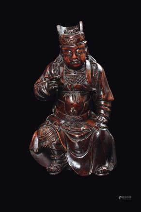 A carved wood figure of Guandi, China, Ming Dynasty, 17th century