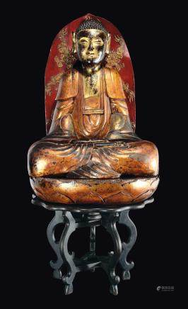 A large carved gilt and lacquered wood figure of Buddha with aura on a lotus flower, Southern China, Qing Dynasty, 19th century