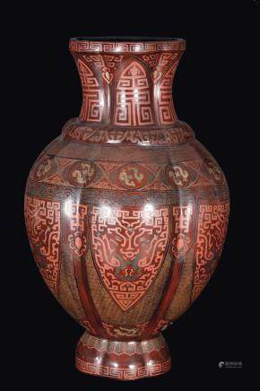 A large red-lacquered vase with taotie mask decoration, China, Qing Dynasty, late 19th century