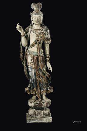 A large and important carved polychrome and gilt wood figure of standing Bodhisattva on a lotus flower, China, Ming Dynasty, 15th century