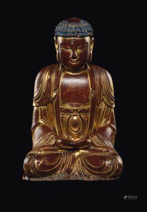 A gilt and lacquered wood figure of seated Buddha, China, Qing Dynasty, 18th century