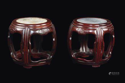 A pair of carved wood stools with bats in relief and marble plane, China, Qing Dynasty, 19th century