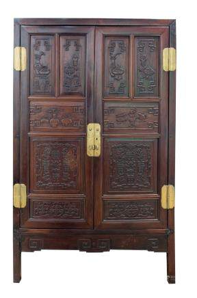 A huali compound cabinet with naturalistic carving, China, Qing Dynasty, 19th century