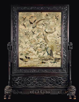 A carved wood firescreen with a silk cloth embroidered with birds, peacocks and roses, China, Qing Dynasty, 19th century