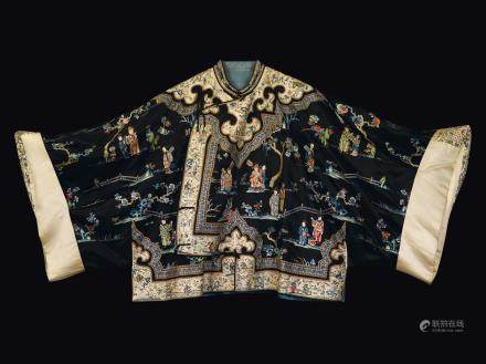 A blue-ground silk dress with Guanyin and dignitaries, China, Qing Dynasty, 19th century