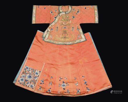 A salmon pink-ground dress with blue flowers, China, Qing Dynasty, 19th century