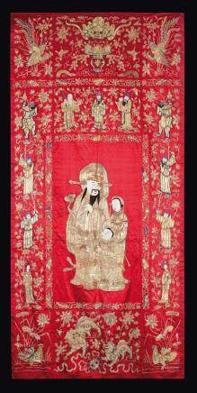 Four red-ground silk clothes embroidered with Guanyin, dignitaries and animals, China, Qing Dynasty, 19th century