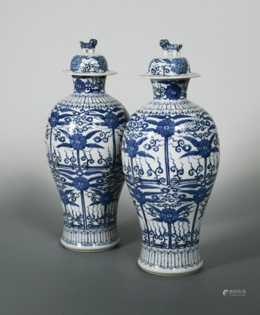 A pair of Chinese blue and white export porcelain baluster vases and covers, Qing Dynasty, circa