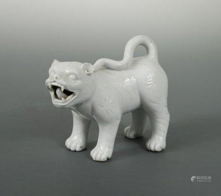A Japanese white glazed porcelain standing model of a Shi-Shi, probably Hirado Kilns, Meiji Period