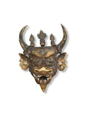 A Tibetan bronze mask of Dharmapala Yamantaka,