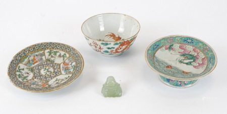 A greenstone Buddha carving, together with a raised Chinese dish with dragon emerging from the