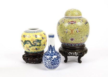 Two Chinese Qing dynasty ginger jars, with polychrome decoration of flowers and dragons upon a