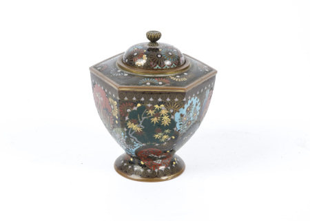 A Japanese Meiji period lidded hexagonal topped jar with cloisonné enamel decoration, with