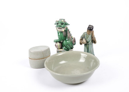 A Chinese famille verte Kylin resting upon a pierced sphere, together with a celadon glazed bowl