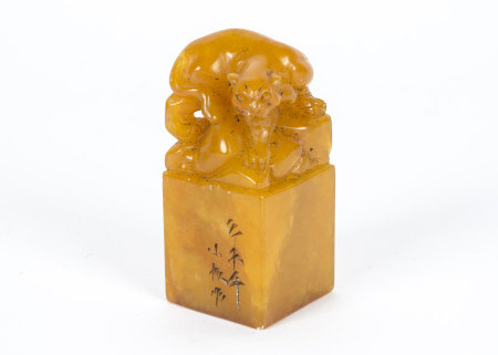 A late 19th/early 20th Century Chinese soapstone weight, the terminal fashioned as a panther,