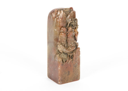 A late 19th/early 20th Century Chinese soapstone weight, the terminal fashioned as a mountain