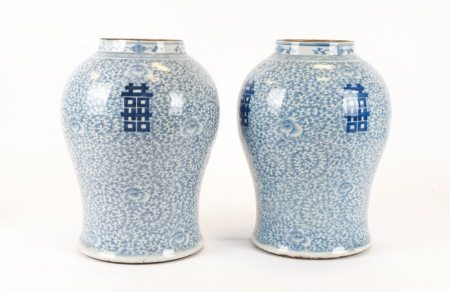 A pair of mid 19th Century Chinese porcelain vases or jars, with profuse underglaze blue