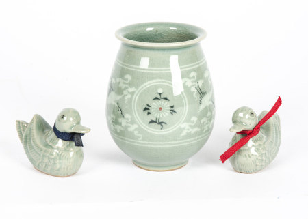 A celadon glazed vase, decorated with cranes, clouds and flowers, together with two Chinese