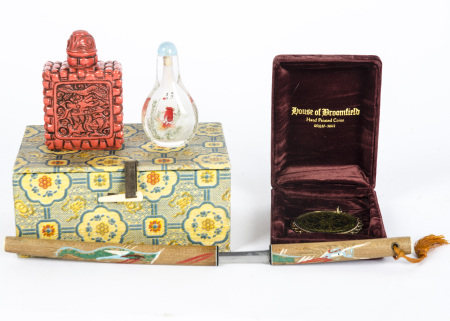 A Chinese pair of snuff containers in case, one a glass bottle with decoration of goldfish, the