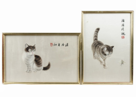 A pair of Republic period 20th Century Chinese silks of cats, one standing watchful, the other