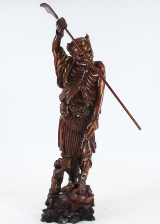 A large Japanese figure, formed from carved boxwood, a Tanuki Samurai with Oni demon around waist,