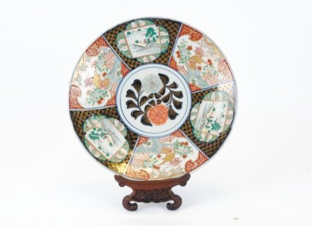 A large Japanese Imari charger, the six cartouches decorated with alternating designs of mythical