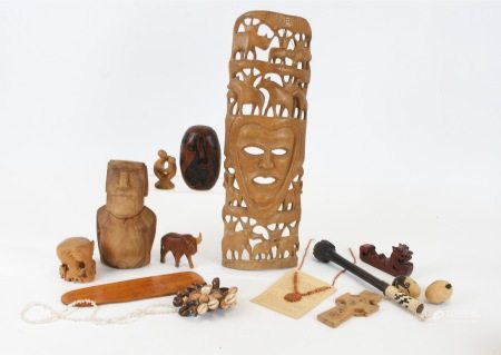 A group of Maori and Easter Island objects, to include a green stone pendant, another Maori pendant,