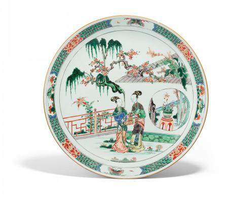 LARGE DISH WITH TWO LADIES IN A GRADEN LANDSCAPE.