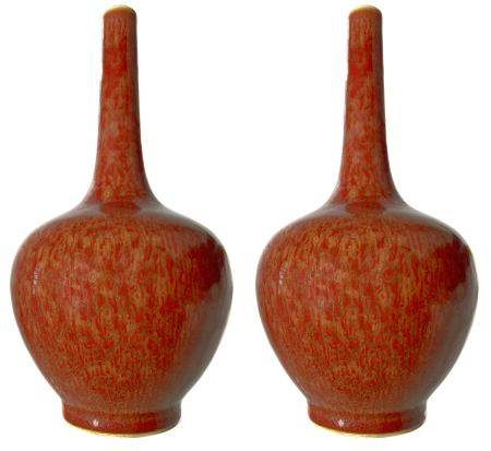 Pair of bottle vases with uniform red streaks of light base over the entire surface. Mark
