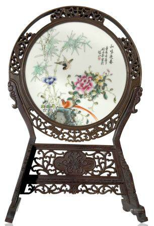 Circular porcelain plate depicting bamboo, birds, and peony flower, a symbol of good luc, and