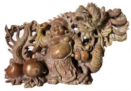 Sophisticated and detailed stone carving soapstone depicting Budai with dragon, fruit and clouds.