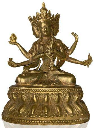 bronze sculpture of the goddess Tara depicted with eight arms and three heads. Tibet, 19th / 20th