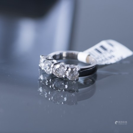 A FOUR-TIER DIAMOND RING, AIGL CERTIFIED